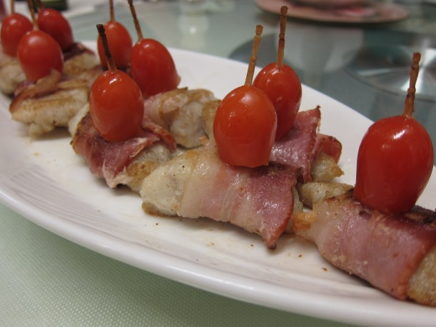 Fish wrapped with bacon