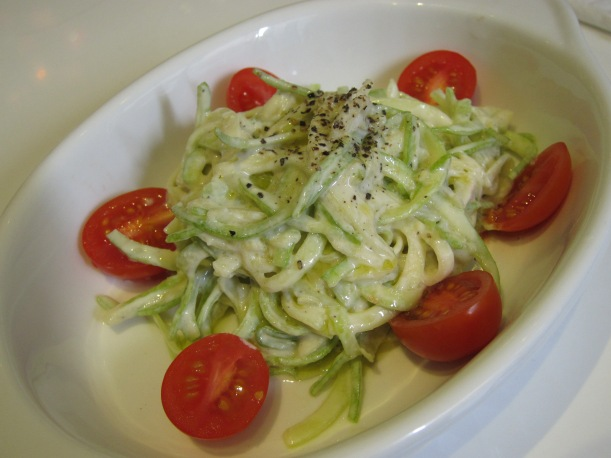Fettuccine shaped courgette with creamy cashew-truffle sauce