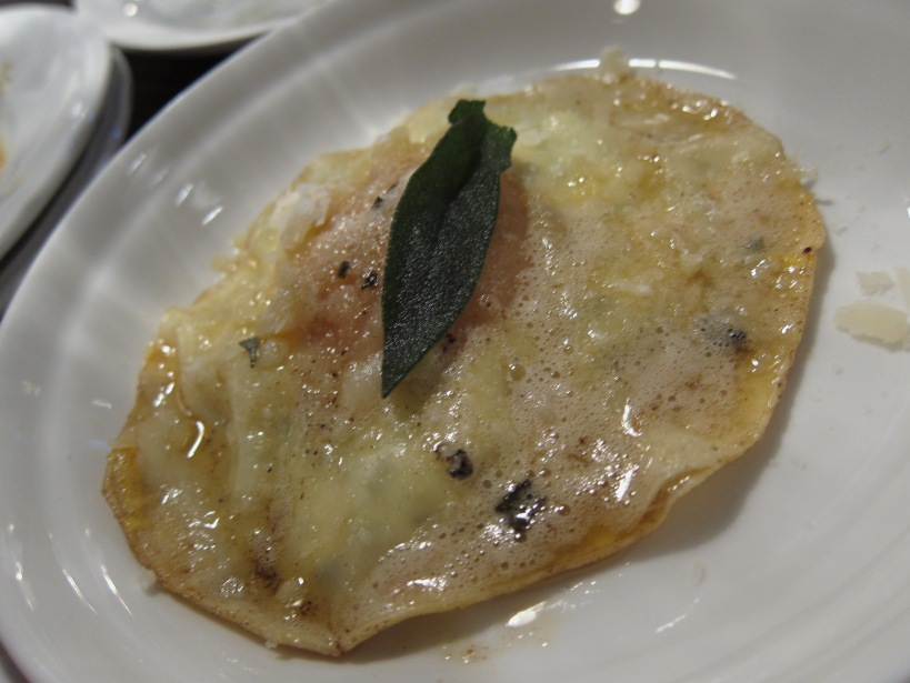 Soft duck egg raviolo