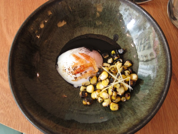 Hen egg with squid ink, girlled corn kernels